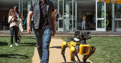 Amazon CEO, Jeff Bezos, takes a walk with his robot dog at MARS