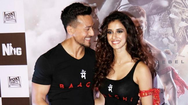 Disha Patani and Tiger Shroff  are in bed busy discussing about this…