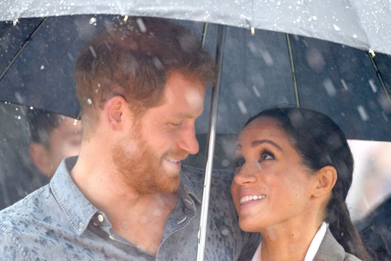 Meghan Markle Gloriously Holds Prince Harry's Umbrella