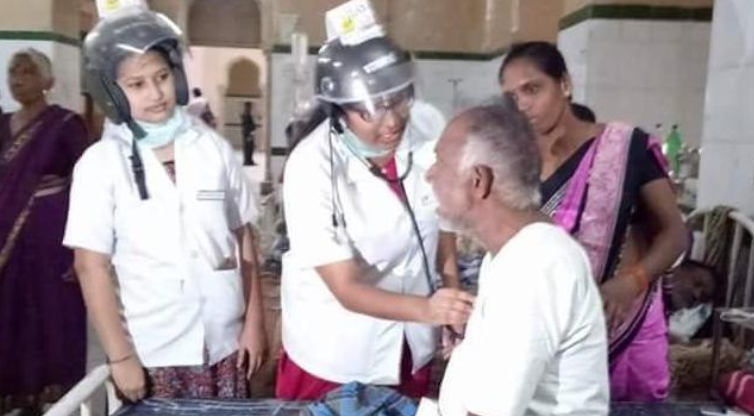Doctors treating patient wearing helmet in Osmania