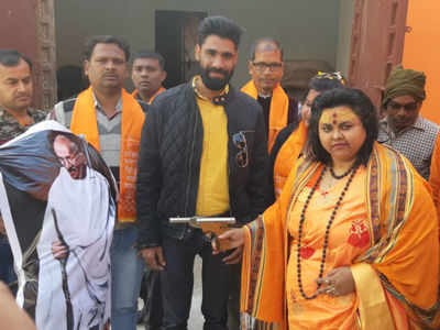Hindu Mahasabha leader Pooja Shakun arrested by the UP police for shooting at Mahatma Gandhi Effigy