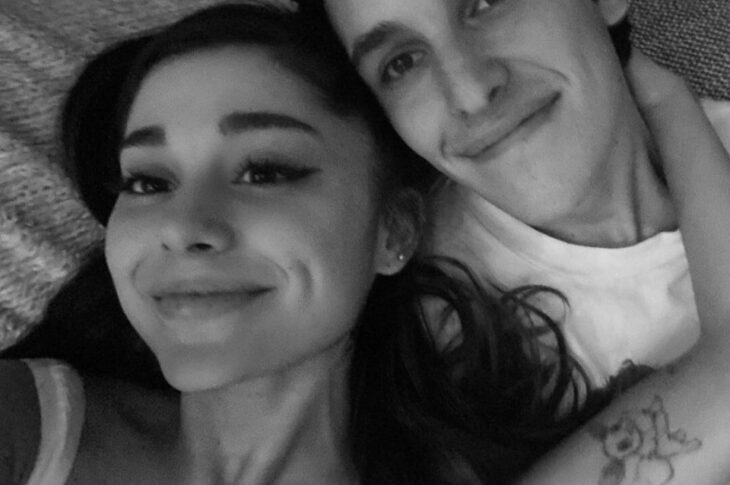 """On Sunday, singer showed off her new diamond engagement ring in photos shared on Instagram. """"Forever n then some,"""" Grande captioned the series of images, which included a close look at her engagement ring. Congrats poured in,on her post, by her family, friends and fans! """"Congrats to these two amazing souls. Ari we love you and could not be happier for you. Dalton you are a lucky man,"""" her manager Scooter Braun commented. """"YAYYYYYY!!!!"""" added Hailey Baldwin. """"So happy for you guys!!"""" The newly engaged couple received congratulations from a myriad of loved ones. Grande's mom Joan tweeted, """"I am so excited to welcome Dalton Gomez into our family! Ariana, I love you and Dalton so much!!! Here's to happily ever after! YAY! xoxoxo."""" The pair made things Instagram official in June when she shared a gallery on the photo-sharing app that featured photos and videos of her pups, a childhood photo and a sweet image of herself cuddling with Gomez. Everyone went gala over their pictures. We can't wait to see them get married! The couple had been dating since January and were social distancing together at her Los Angeles home amid the ongoing coronavirus pandemic. """"Ariana doesn't want to do another public relationship so she is trying to keep this one quiet, but she seems very happy with Dalton,"""" Gomez serves as the sole buyers' agent for Aaron Kirman Group in Los Angeles. According to his bio listed on his real estate group's website, Gomez is a 5 year veteran of the Luxury Real Estate Market, served as the Director of Operations during his first 3 years with the company, and has represented significant sales including Pierre Koenig's Case Study #21 and Craig Ellwood's Case Study #16. He also represents the only Oscar Niemeyer House in North America and many other notable works by architects such as Neutra, Lautner, A. Quincy Jones, etc. The singer first confirmed her new relationship in the music video for her single with Justin Bieber, """"Stuck With U,"""" in which the couple could """